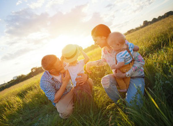 young-family-with-kids-in-the-park-picture-id478786644